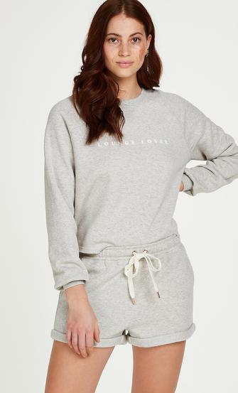 Shorts i borstad sweatshirt, Beige
